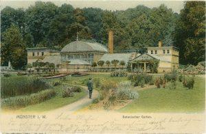 Mondäne Grünanlage: Parklandschaft und historische Gebäude im Botanischen Garten zeigt diese Ansichtskarte.
