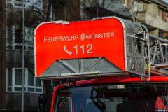 Germania Campus - Frau kletterte auf Schornstein